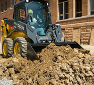 JD grading bucket for skid steers and track loaders