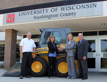 Skid steer donation to UW Washington County