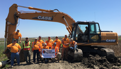 Donated excavator and training for wetland development